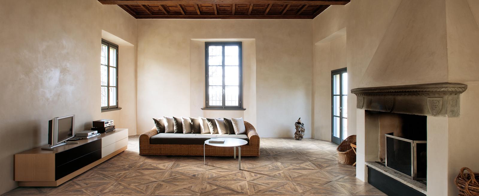 Porcelain tiles that look like assembled parquet panels - Baita
